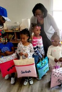 Students lined up a few at at time to recieve their gifts